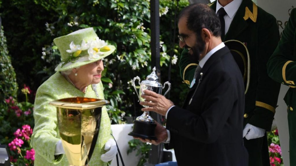 Queen Elizabeth II presents Sheikh Mohammed bin Rashid, Vice President and Ruler of Dubai, with the Diamond Jubilee trophy.