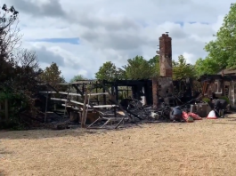 The remains of the fire that devasted a bungalow at his Old Malthouse stables in Upper Lambourn