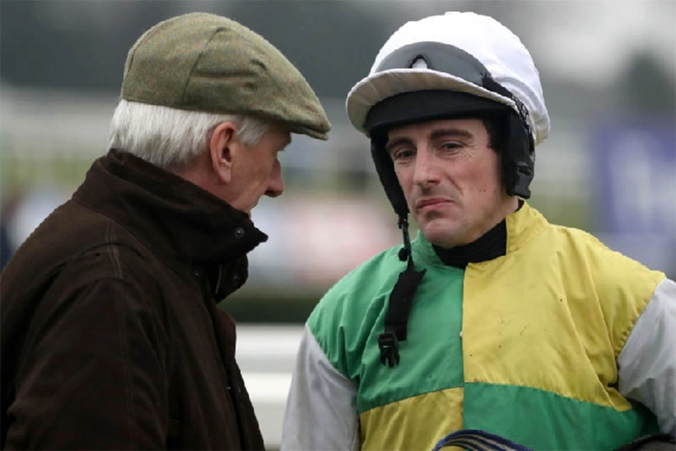 Mick Meager chatting to jockey Brian Hughes